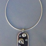 Sterling Silver Pendant Featuring Dickinsonia,
